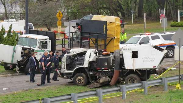 Investigators at the scene of a fatal accident