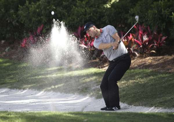 Martin Kaymer hits from a sand trap on