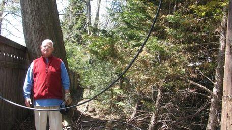 Peter Harding amid loops of damaged Verizon wires