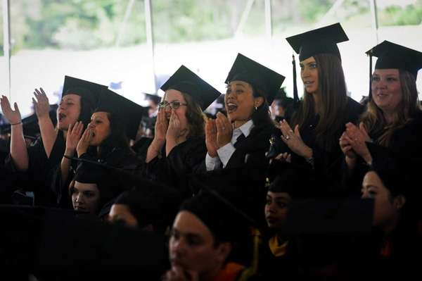 Graduating students cheer during the ceremony as LIU