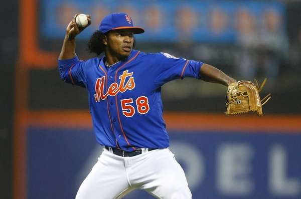 Jenrry Mejia throws for an out in the