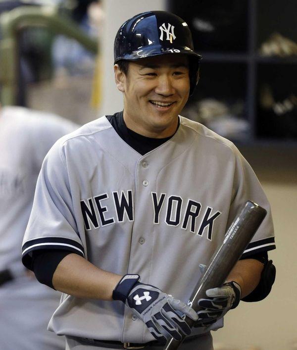 Yankees starting pitcher Masahiro Tanaka stands in the