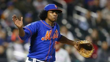 Jenrry Mejia reacts after the final out of