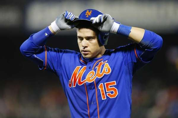 Travis d'Arnaud #15 of the Mets reacts after