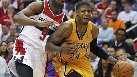 Indiana Pacers forward Paul George drives past Washington