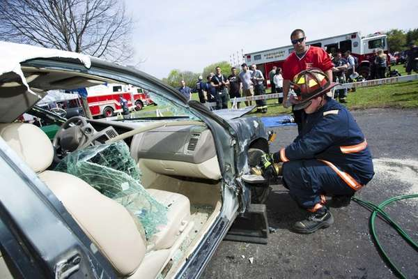 Members of the West Babylon Fire Department compete