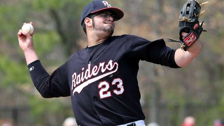 Patchogue-Medford starting pitcher Andy Garcia delivers against Longwood
