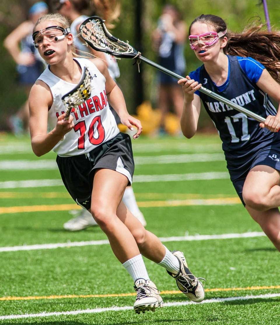 Long Island Lutheran's Nicole Sinacori, left, gets around