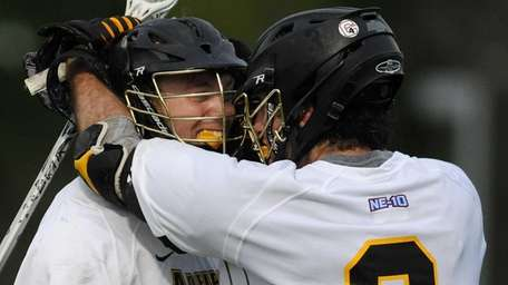 Adelphi's Salvatore Tuttle, left, gets congratulated by teammate