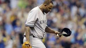 Yankees starting pitcher CC Sabathia looks down after