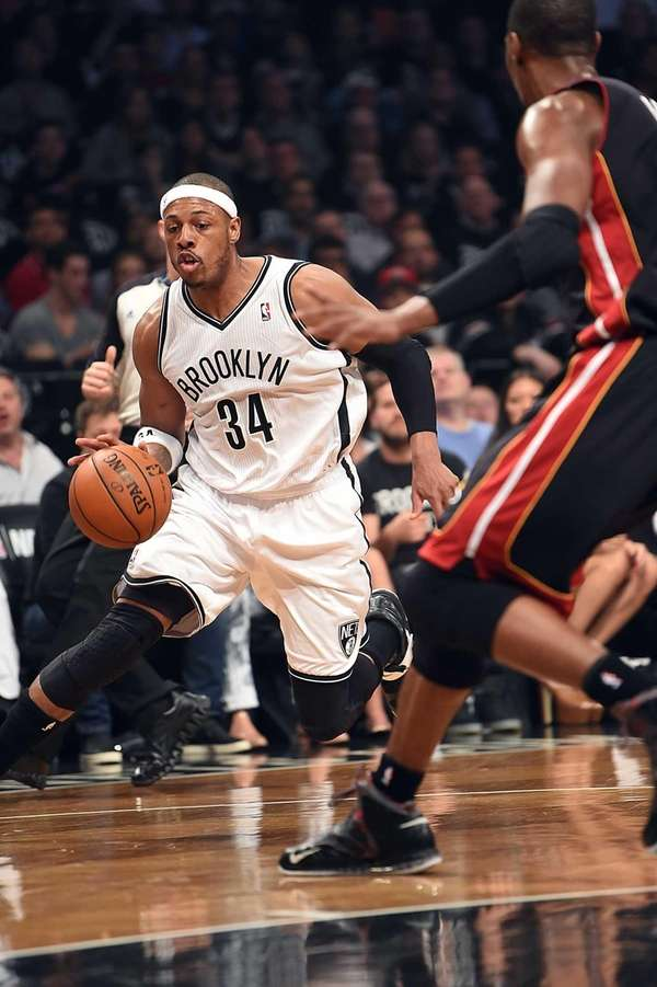 Nets' Paul Pierce drives against Miami Heat's Chris