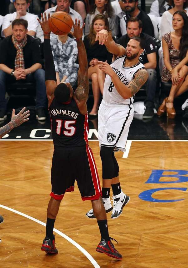 Deron Williams of the Nets passes the ball