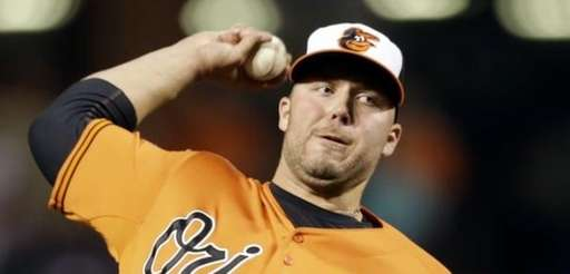 Baltimore Orioles relief pitcher Tommy Hunter throws to