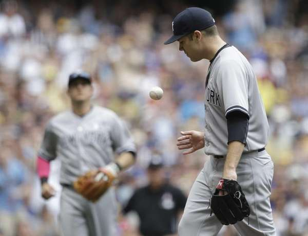 Yankees starting pitcher David Phelps reacts to a