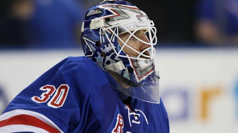 Henrik Lundqvist looks on in the first period