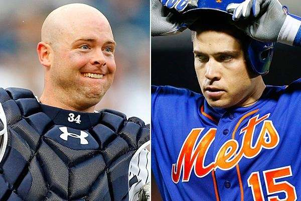 Yankees catcher Brian McCann and Mets catcher Travis