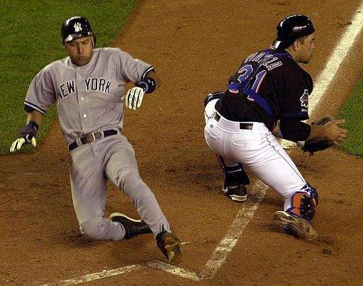 Derek Jeter slides into home as the Mets'