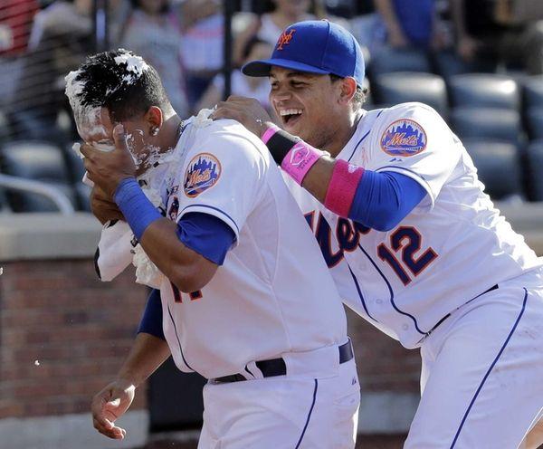 Mets centerfielder Juan Lagares (12) gives shortstop Ruben