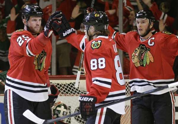 Chicago Blackhawks' Bryan Bickell (29), left, celebrates with