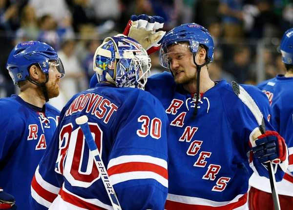 Henrik Lundqvist celebrates the Rangers' 3-1 win over
