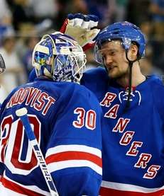 Henrik Lundqvist celebrates the Rangers' 3-1 win over