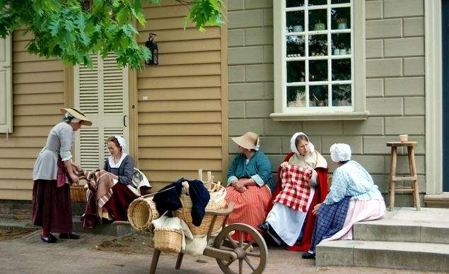 Staff at Colonial Williamsburg in Virginia dress and