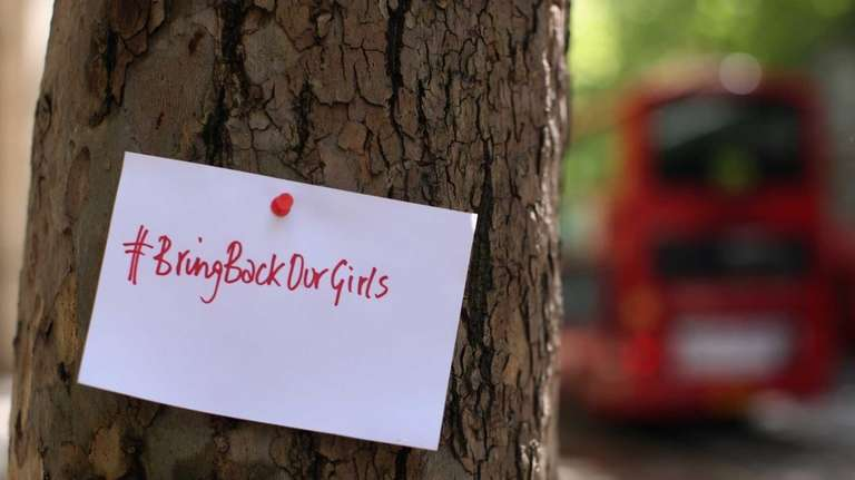 A sign that reads 'Bring back our girls'