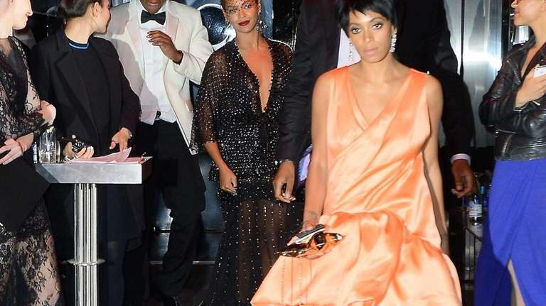 Beyoncé, center, Jay Z and Solange Knowles leaving