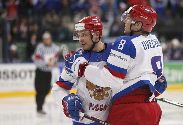 Russia defender Denis Denisov, left and forward Alexander