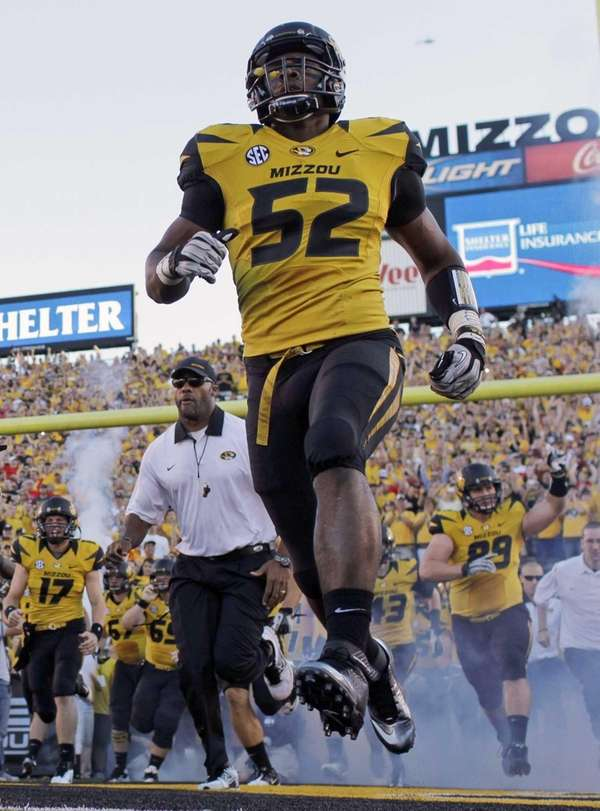 Missouri's Michael Sam (52) runs onto the field
