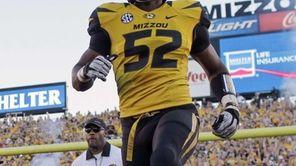 Missouri's Michael Sam (52) runs onto the field