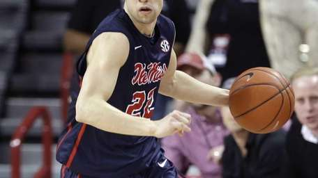 Mississippi guard Marshall Henderson dribbles the ball in