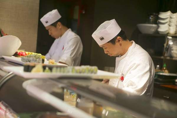 Sushi chefs prepare meals at Nisen 347 in