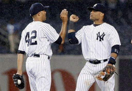 Mariano Rivera (42) and Robinson Cano (24) celebrate