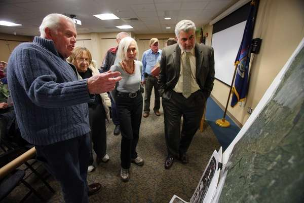 Residents look at two aerial maps of Smithtown,
