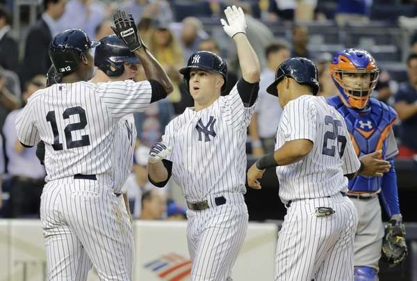 Yankees batter Brett Gardner, center, is welcomed at