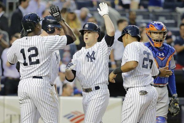 Yankees batter Brett Gardner, center, is welcomed at