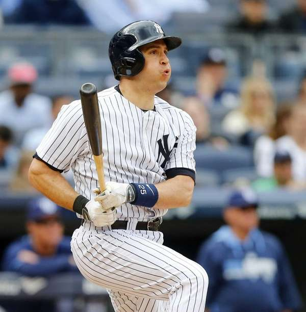 Mark Teixeira follows through on a two-run base
