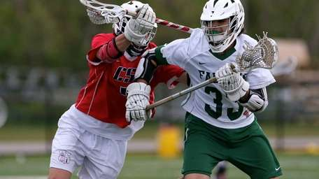 Locust Valley's Angelo Caiazzo fights off the check