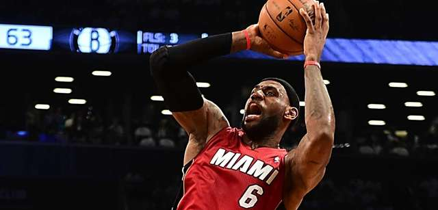 The Miami Heat's LeBron James is fouled while