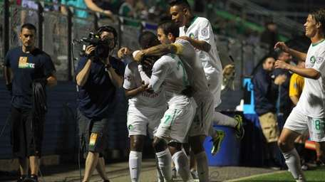 The Cosmos celebrate a goal by midfielder Marcos