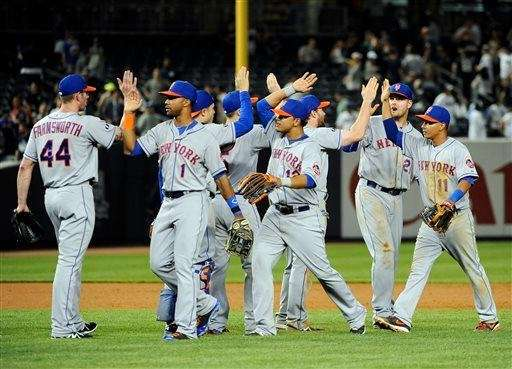 The Mets' Kyle Farnsworth (44), Chris Young (1),