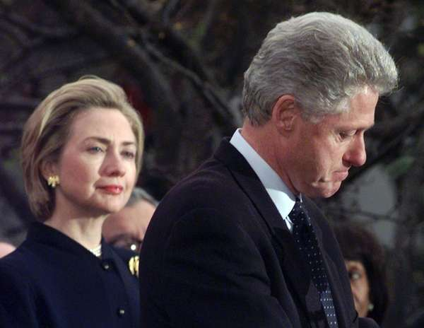 First lady Hillary Rodham Clinton watches President Clinton