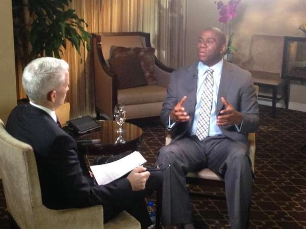 Magic Johnson speaks with Anderson Cooper during an