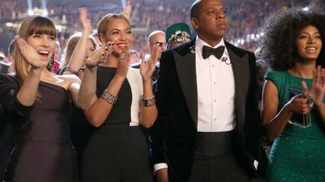 Beyonce, Jay Z and Solange Knowles attend the