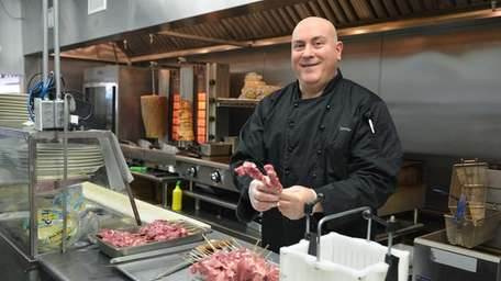 Chef Peter Mesaris makes souvlaki skewers in the