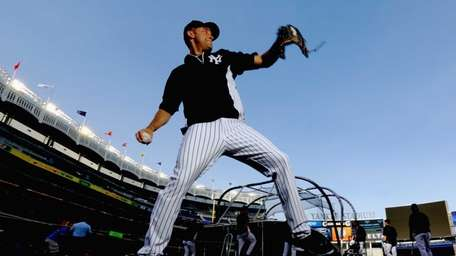 The Yankees' Derek Jeter throws the ball during