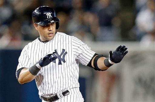 Carlos Beltran gestures after hitting a seventh-inning double