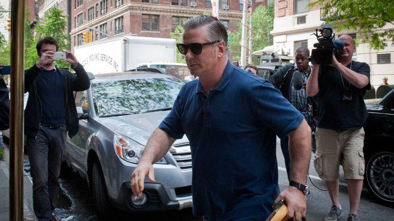 Alec Baldwin returns to his Greenwich Village apartment