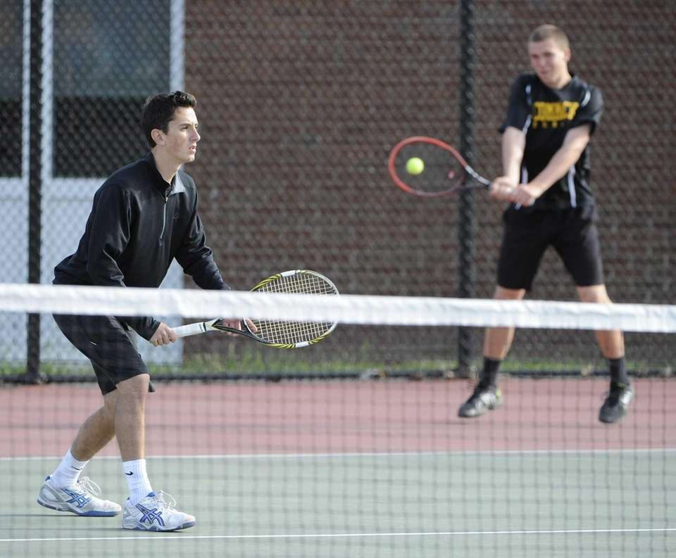 Commack's Cory Seltman, right, and Nick Fox play